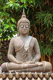 Buddha posture meditation. Made form old nut Stock Photos
