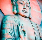 Buddha Profile. A wall mural of a Buddha in an Buddhist temple Stock Image