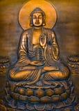 Buddha Profile. A Buddha sitting on lotus and holding a pagoda Royalty Free Stock Photo