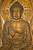 Buddha Profile. A Buddha sitting on lotus and blessing a lotus urn Royalty Free Stock Photography