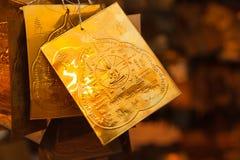 Buddha pump on golden plate Royalty Free Stock Photo
