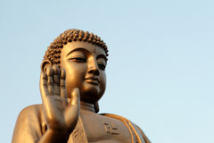 Buddha raises his hand Royalty Free Stock Image
