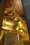 Buddha. Reclining Buddha in thai temple Stock Image