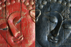 Buddha - red and blue. Wood sculpture of the Buddha in red and blue Stock Photography