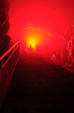 Buddha with red light. In cave Royalty Free Stock Image