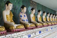 Buddha-Reihe Stockbild