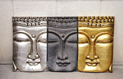 Buddha relief. Relief with three buddha heads royalty free stock photo