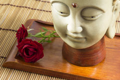 Buddha with rose Stock Images