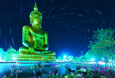 Buddha with  rotating stars in Thailand. The Buddha with rotating star  on a  night Royalty Free Stock Photo