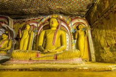 Cave temple complex in Dambulla, Sri Lanka. Buddha`s in the cave temple complex in Dambulla, Sri Lanka Stock Photo