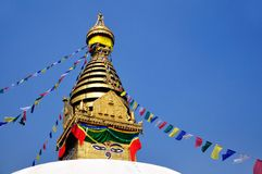 Buddha's Eyes with Praying Flags at Swayambhunath. Buddha's Eyes at Swayambhunath, Katmandu, Nepal stock photos