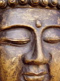 Buddha's Face. Close up shot of the Buddha's face carved out of wood royalty free stock images