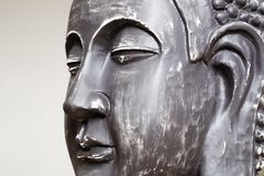 Buddha`s face close-up. The Buddha image in ceramics. The texture of the background and focus of the soft focus. For an atmosphere of meditation royalty free stock photo