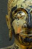 Buddha's face close up focus on eye. Royalty Free Stock Photo