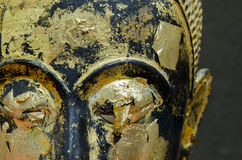 Buddha's face close up focus on eye. Stock Image