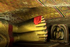 Buddha's feet in Dambulla Cave Temple Royalty Free Stock Photo