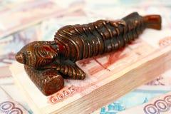 Buddha's figurine & money stack Royalty Free Stock Photo