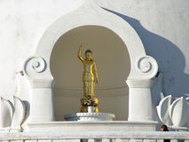 Buddha's Greetings. Golden statue of buddha waves to visitors at the entrance of the peace pagoda in leverett massachusetts Royalty Free Stock Photo