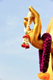 Buddha's hand and garland Stock Photography