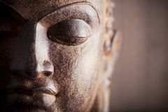 Buddha's head. On a brown background Stock Photography