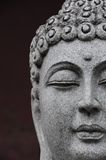 Buddha's head. On a brown background Royalty Free Stock Photography