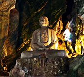 Buddha in a cave in Marble Mountain, Hoi An, Vietnam royalty free stock photo