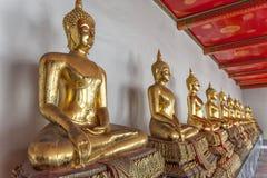 Buddha's in Wat Pho Temple, Bangkok, Thailand. Golden buddha's in the Wat Pho temple in Bangkok, Thailand royalty free stock images