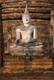 buddha sa si sitter statysukhothaiwat Arkivbild