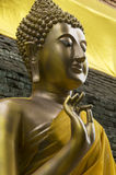 Buddha with saffron robe Stock Photo