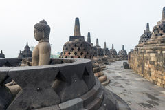 Buddha sculpture at Borobudur Royalty Free Stock Images