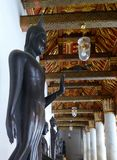 Buddha sculpture in the compound passage around Ubosodh od Wat Phra Kaew , Bangkok Thailand Stock Image