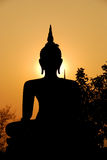 Buddha sculpture and evening sunlight Royalty Free Stock Photography