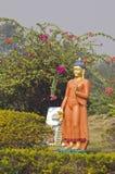 Buddha sculpture in garden near temple,Lumbini Stock Photo