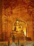 Buddha sculpture. Golden Buddha sculpture in Thai temple Stock Photo