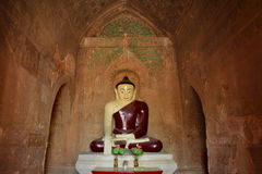 Buddha sculpture inside old pagoda with ancient paintings on the royalty free stock image