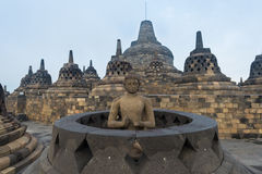 Buddha sculpture inside open stupa at Borobudur Stock Photography