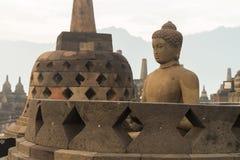 Buddha sculpture inside open stupa Stock Photo