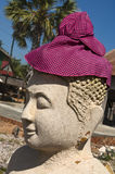 Buddha sculpture with Krama head cover Stock Photos