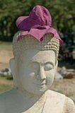 Buddha sculpture with Krama head cover Stock Photo