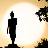 Buddha sculpture silhouette Stock Images