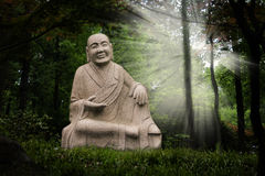 Buddha statue in enchanted garden Royalty Free Stock Images