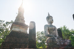 Buddha sculpture and temple ruins Royalty Free Stock Images