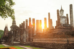 Buddha sculpture and temple ruins Stock Photo