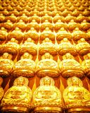 Buddha sculpture wall. Golden Buddha sculpture in Chinese stock image