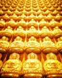 Buddha sculpture wall. Golden Buddha sculpture in Chinese Stock Image