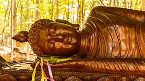 Buddha sculpture in wood Royalty Free Stock Image