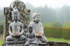 Buddha sculptures. Three Buddha sculptures in nature Stock Image