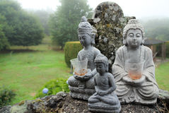 Buddha sculptures. Three Buddha sculptures in nature Royalty Free Stock Images