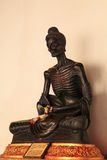Buddha seated cross-legged. In the attitude subduing himself by fasting stock photography