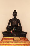 Buddha seated cross-legged. In the attitude subduing himself by fasting royalty free stock image